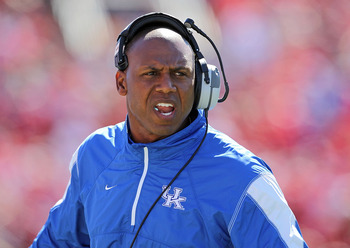 LOUISVILLE, KY - SEPTEMBER 04: Joker Phillips the Head Coach of the Kentucky Wildcats gives instructions to his team during the game against the Louisville Cardinals at Papa John's Cardinal Stadium on September 4, 2010 in Louisville, Kentucky.  (Photo by