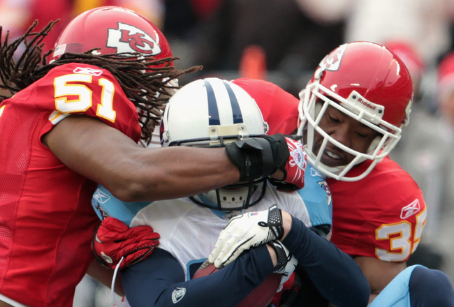 KANSAS CITY, MO - DECEMBER 26:  Marc Mariani #83 of the Tennessee Titans is tackled by Corey Mays #51, Ricky Price #35, and Verran Tucker #15 of the Kansas City Chiefs during the game on December 26, 2010 at Arrowhead Stadium in Kansas City, Missouri.  (P