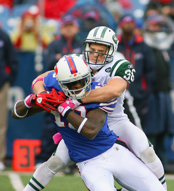 ORCHARD PARK, NY - OCTOBER 03: Jim Leonard #36  of the New York Jets strips the ball from Steve Johnson #13 of  the Buffalo Bills at Ralph Wilson Stadium on October 3, 2010 in Orchard Park, New York. The Jets won 38-14. (Photo by Rick Stewart/Getty Images
