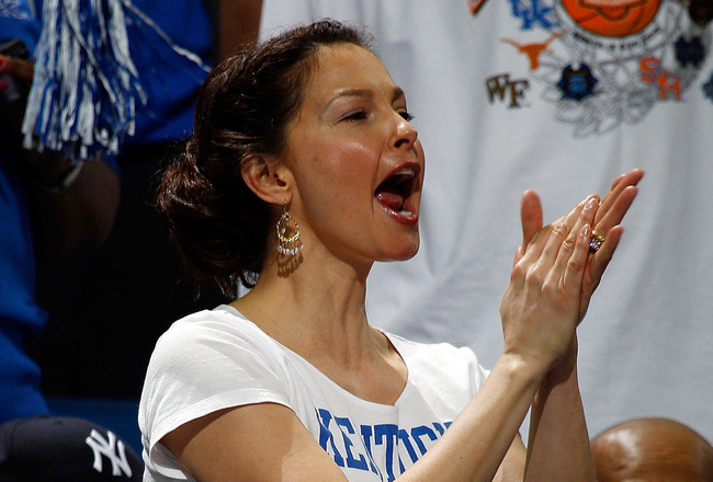 NEW ORLEANS - MARCH 20:  Actress Ashley Judd cheers for the Kentucky Wildcats during the game against the Wake Forest Demon Deacons during the second round of the 2010 NCAA men's basketball tournament at the New Orleans Arena on March 20, 2010 in New Orle