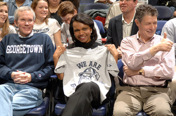 WASHINGTON - MARCH 8:  US Secretary of State Condoleezza Rice attends a Georgetown Hoyas basketball game against the Louisville Cardinals at Verizon Center on March 8, 2008 in Washington, D.C.  (Photo by Mitchell Layton/Getty Images)