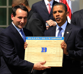 WASHINGTON - MAY 27:  U.S. President Barack Obama (R) is presented with a plaque of a bracket by coach Mike Krzyzewski (L) of the Duke Blue Devils during a Rose Garden event May 27, 2010 at the White House in Washington, DC. Obama hosted the NCAA men bask