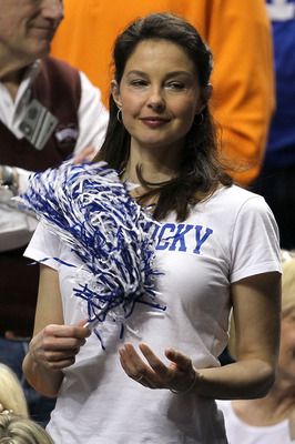NASHVILLE, TN - MARCH 13:  Actress Ashley Judd cheers for the Kentucky Wildcats against the Tennessee Volunteers during the semirfinals of the SEC Men's Basketball Tournament at the Bridgestone Arena on March 13, 2010 in Nashville, Tennessee.  (Photo by A