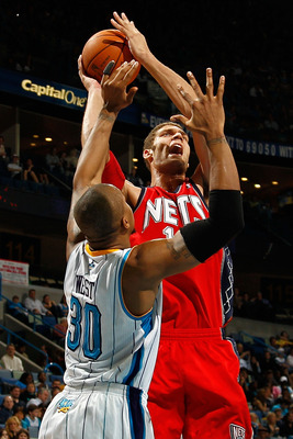 NEW ORLEANS, LA - DECEMBER 22:  Brook Lopez #11 of the New Jersey Nets shoots the ball over David West #30 of the New Orleans Hornets at the New Orleans Arena on December 22, 2010 in New Orleans, Louisiana.    The Hornets defeated the Nets 105-91.   NOTE