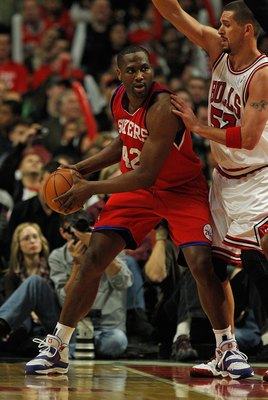 CHICAGO - FEBRUARY 20: Elton Brand #42 of the Philadelphia 76ers looks to pass under pressure from Brad Miller #52 of the Chicago Bulls at the United Center on February 20, 2010 in Chicago, Illinois. The Bulls defeated the 76ers 122-90. NOTE TO USER: User