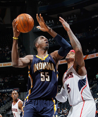 ATLANTA, GA - DECEMBER 11:  Roy Hibbert #55 of the Indiana Pacers drives against Josh Smith #5 of the Atlanta Hawks at Philips Arena on December 11, 2010 in Atlanta, Georgia.  NOTE TO USER: User expressly acknowledges and agrees that, by downloading and/o