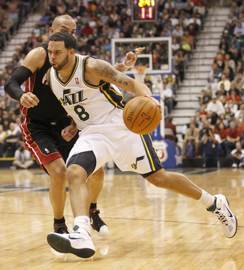 SALT LAKE CITY, UT - DECEMBER 8:  Deron Williams #8 of the Utah Jazz drives on Carlos Arroyo #8 the Miami Heat during the second half of an NBA game December 8, 2010 at Energy Solutions Arena in Salt Lake City, Utah. The Heat beat the Jazz 111-98. NOTE TO