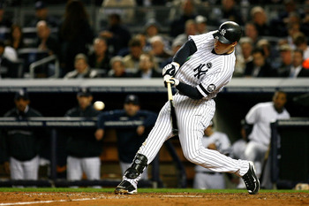 NEW YORK - OCTOBER 19:  Mark Teixeira #25 of the New York Yankees bats against the Texas Rangers in Game Four of the ALCS during the 2010 MLB Playoffs at Yankee Stadium on October 19, 2010 in the Bronx borough of New York City.  (Photo by Andrew Burton/Ge