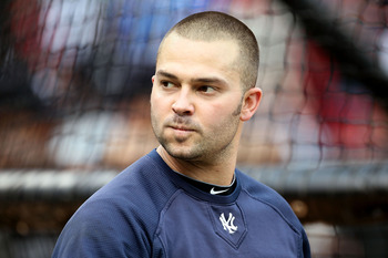 ARLINGTON, TX - OCTOBER 22:  Nick Swisher #33 of the New York Yankees looks on during batting practice against the Texas Rangers in Game Six of the ALCS during the 2010 MLB Playoffs at Rangers Ballpark in Arlington on October 22, 2010 in Arlington, Texas.