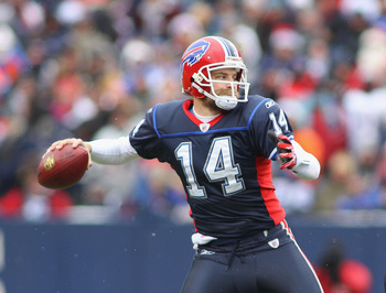 ORCHARD PARK, NY - DECEMBER 26:  Ryan Fitzpatrick #14 of the Buffalo Bills readies to pass against the New England Patriots at Ralph Wilson Stadium on December 26, 2010 in Orchard Park, New York.  (Photo by Rick Stewart/Getty Images)
