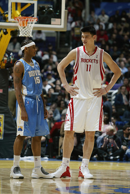 LOS ANGELES - FEBRUARY 13:  Carmelo Anthony #15 of the Rookie Team stands next  Yao Ming #11 of the Sophomore Team during the Got Milk? Rookie Challenge, part of the 53rd NBA All-Star weekend, at Staples Center on February 13, 2004 in Los Angeles, Califor
