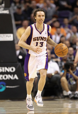PHOENIX - DECEMBER 15:  Steve Nash #13 of the Phoenix Suns moves the ball upcourt during the NBA game against the Minnesota Timberwolves at US Airways Center on December 15, 2010 in Phoenix, Arizona.  The Suns defeated the Timberwolves 128-122.  NOTE TO U