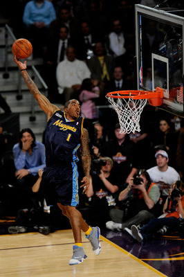 PHOENIX - FEBRUARY 14:  J.R. Smith of the Denver Nuggets participates in the Sprite Slam Dunk Contest on All-Star Saturday Night, part of 2009 NBA All-Star Weekend at US Airways Center on February 14, 2009 in Phoenix, Arizona.  NOTE TO USER: User expressl