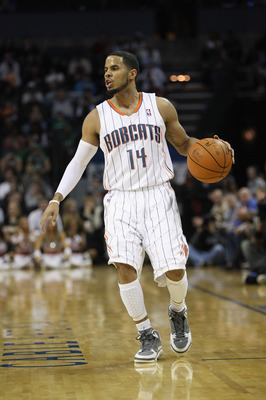 CHARLOTTE, NC - DECEMBER 11:  D.J. Augustin #14 of the Charlotte Bobcats against the Boston Celtics during their game at Time Warner Cable Arena on December 11, 2010 in Charlotte, North Carolina. NOTE TO USER: User expressly acknowledges and agrees that,