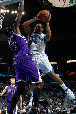 NEW ORLEANS, LA - DECEMBER 15:  Marcus Thornton #5 of the New Orleans Hornets shoots the ball over Samuel Dalembert #10 of the Sacramento Kings at the New Orleans Arena on December 15, 2010 in New Orleans, Louisiana.  The Hornets defeated the Kings 94-91.