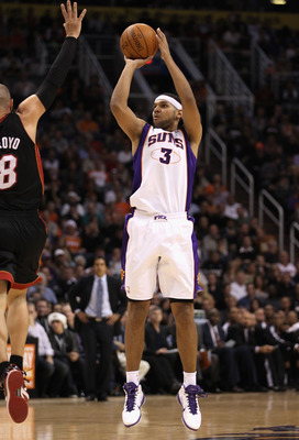 PHOENIX - DECEMBER 23:  Jared Dudley #3 of the Phoenix Suns puts up a three point shot against the Miami Heat during the NBA game at US Airways Center on December 23, 2010 in Phoenix, Arizona. NOTE TO USER: User expressly acknowledges and agrees that, by