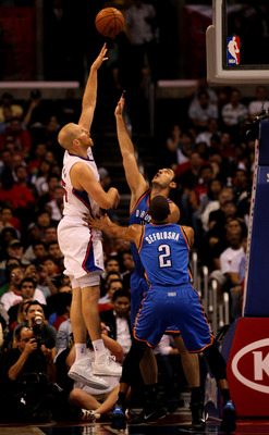 LOS ANGELES - NOVEMBER 3:  Chris Kaman #35 of the Los Angeles Clippers shoots over Nenad Krstic #12 and Thabo Sefolosha #2 of the Oklahoma City Thunder at Staples Center on November 3, 2010 in Los Angeles, California.  NOTE TO USER: User expressly acknowl