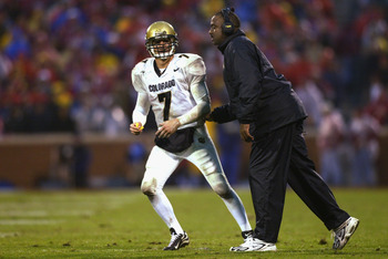 NORMAN, OK - NOVEMBER 2:  Quarterback Robert Hodge #7 of the Colorado Buffaloes gets instruction by Wide Receivers coach Jon Embree during the game against the Oklahoma Sooners at Memorial Stadium on November 2, 2002 in Norman, Oklahoma.  The Sooners won
