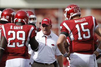 FAYETTEVILLE - SEPTEMBER 25: Arkansas Razorbacks head coach Bobby Petrino (C) talks to his players during the game against the Alabama Crimson Tide at Donald W. Reynolds Razorback Stadium on September 25, 2010 in Fayetteville, Arkansas. Alabama won 24-20.