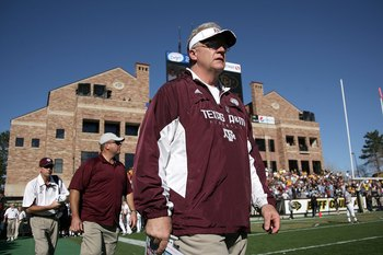 BOULDER, CO - NOVEMBER 07:  Head coach Mike Sherman of the Texas A&M Aggies enters the field for the second half as he leads his team against the Colorado Buffaloes during NCAA college football action at Folsom Field on November 7, 2009 in Boulder, Colora