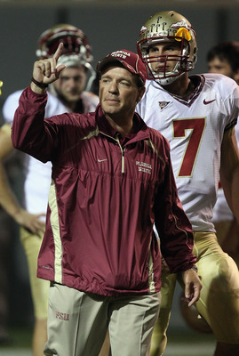RALEIGH, NC - OCTOBER 28:  Head coach Jimbo Fisher and quarterback Christian Ponder #7 of the Florida State Seminoles prepare for their game against the North Carolina State Wolfpack at Carter-Finley Stadium on October 28, 2010 in Raleigh, North Carolina.