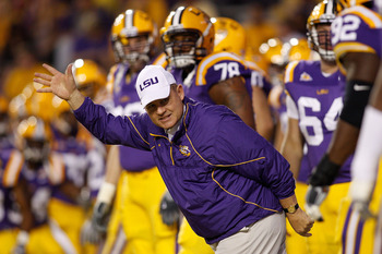 BATON ROUGE, LA - NOVEMBER 13:  Head coach Les Miles of the Louisiana State University Tigers runs on to the field during pregame before playing the  Louisiana Monroe Warhawks at Tiger Stadium on November 13, 2010 in Baton Rouge, Louisiana.  (Photo by Chr