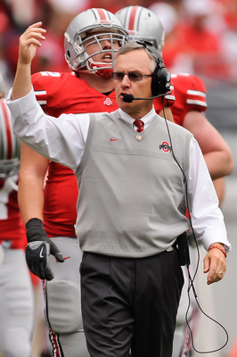 COLUMBUS, OH - OCTOBER 23:  Head Coach Jim Tressel of the Ohio State Buckeyes calls his team together during a game against the Purdue Boilermakers at Ohio Stadium on October 23, 2010 in Columbus, Ohio.  (Photo by Jamie Sabau/Getty Images)