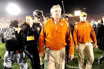PASADENA, CA - JANUARY 07:  Head Coach Mack Brown of the Texas Longhorns walks on the field after losing the Citi BCS National Championship game to the Alabama Crimson Tide at the Rose Bowl on January 7, 2010 in Pasadena, California. The Crimson Tide defe