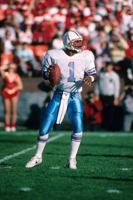 SAN FRANCISCO - NOVEMBER 8:  Quarterback Warren Moon #1 of the Houston Oilers drops back to pass against the San Francisco 49ers defense during a game at Candlestick Park on November 8, 1987 in San Francisco, California.  The 49ers won 27-20.  (Photo by G