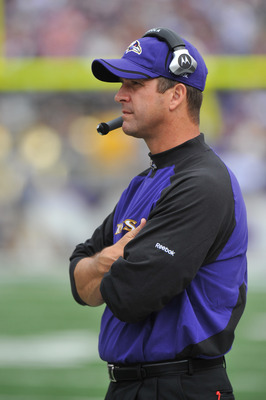 BALTIMORE - SEPTEMBER 26:  Head coach John Harbaugh of the Baltimore Ravens coaches against the Cleveland Browns  at M&T Bank Stadium on September 26, 2010 in Baltimore, Maryland. The Ravens defeated the Browns 24-17. (Photo by Larry French/Getty Images)