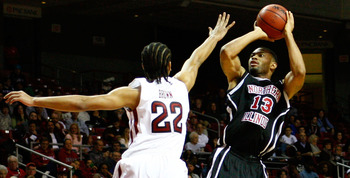 PHILADELPHIA, PA - DECEMBER 18:  Xavier Silas #13 of the Northern Illinois Huskies attempts a shot against Aaron Brown #22 of the Temple Owls at the Liacouras Center on December 18, 2010 in Philadelphia, Pennsylvania.  (Photo by Chris Chambers/Getty Image