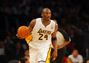 LOS ANGELES, CA - DECEMBER 25:  Kobe Bryant #24 of the Los Angeles Lakers dribbles the ball upcourt on the fastbreak against the Miami Heat during the NBA game at Staples Center on December 25, 2010 in Los Angeles, California. The Heat defeated the Lakers