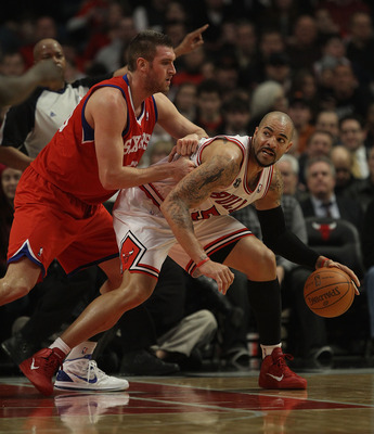 CHICAGO, IL - DECEMBER 21: Carlos Boozer #5 of the Chicago Bulls moves against Spencer Hawes #00 of the Philadelphia 76ers at the United Center on December 21, 2010 in Chicago, Illinois. The Bulls defeated the 76ers 121-76. NOTE TO USER: User expressly ac