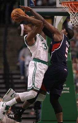 BOSTON, MA - DECEMBER 16:  Paul Pierce #34 of the Boston Celtics is fouled by Josh Smith #5 of the Atlanta Hawks on December 16, 2010 at the TD Garden in Boston, Massachusetts. The Celtics defeated the Hawks 102-90. NOTE TO USER: User expressly acknowledg
