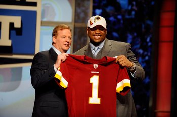 NEW YORK - APRIL 22:  Trent Williams from the Oklahoma Sooners poses with NFL Commissioner ROger Goodell as they hold a Washington Redskins jersey after Washington selected Williams number 4 overall during the first round of the 2010 NFL Draft at Radio Ci