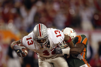 TEMPE, AZ - JANUARY 3:  Running back Maurice Clarett #13 of the Ohio State Buckeyes lunges for the goaline to score the team's second touchdown against the University of Miami Hurricanes during the Tostitos Fiesta Bowl at Sun Devil Stadium on January 3, 2