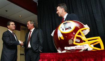 ASHBURN, VA - JANUARY 06:  Mike Shanahan (C) shakes hands with Washington Redskins owner Daniel Snyder (L) as General Manager Bruce Allen (R) looks on before Shanahan was announced as the new head coach of the Washington Redskins on January 6, 2010 in Ash