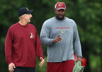 ASHBURN, VA - JULY 29:  Defensive lineman Albert Haynesworth #92 (R) walks with Defensive Coordinator Jim Haslett (L) after the Redskins first day of training camp on July 29, 2010 in Ashburn, Virginia.  (Photo by Win McNamee/Getty Images)