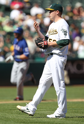 OAKLAND, CA - SEPTEMBER 26:  Jeff Francoeur #21 of the Texas Rangers rounds the bases after hitting a home run off of Trevor Cahill #53 of the Oakland Athletics during a Major League Baseball game at the Oakland-Alameda County Coliseum on September 26, 20