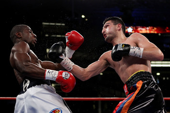 NEW YORK - JUNE 05:  Vanes Martirosyan (R) throws a right to the face of Joe Greene during the NABF & NABO super welterweight fight on June 5, 2010 at Yankee Stadium in the Bronx borough of New York City. Matirosyan wins by unanimous decision 96-93, 96-93