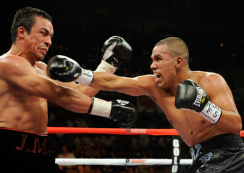 LAS VEGAS - JULY 31:  Juan Diaz  (R) throws a right at WBA/WBO lightweight champion Juan Manuel Marquez in the third round of their bout at the Mandalay Bay Events Center July 31, 2010 in Las Vegas, Nevada. Marquez retained his WBA and WBO lightweight cha