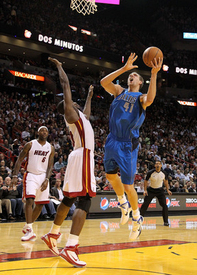 MIAMI, FL - DECEMBER 20:  Dirk Nowitzki #41 of the Dallas Mavericks shoots over Joel Anthony #50 of the Miami Heat during a game at American Airlines Arena on December 20, 2010 in Miami, Florida. NOTE TO USER: User expressly acknowledges and agrees that,
