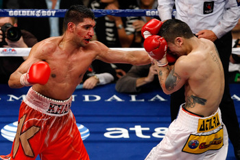 LAS VEGAS - DECEMBER 11:  (L-R) Amir Khan of England throws a left to the face of Marcos Maidana of Argentina during the WBA super lightweight title fight at Mandalay Bay Events Center on December 11, 2010 in Las Vegas, Nevada.  (Photo by Ethan Miller/Get