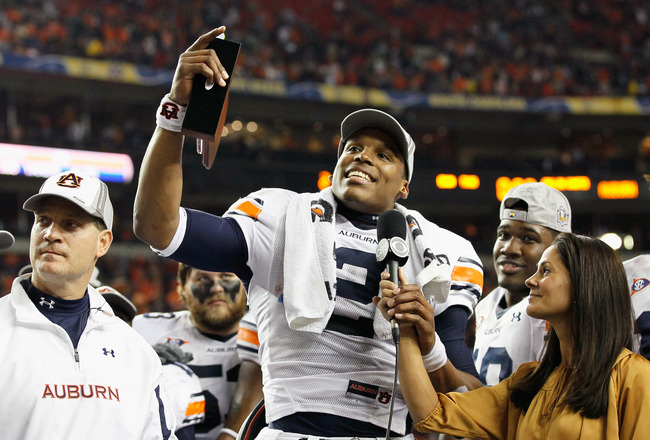ATLANTA, GA - DECEMBER 04:  Quarterback Cam Newton #2 of the Auburn Tigers talks to CBS sideline reporter Tracy Wolfson after winning the MVP trophy in their 56-17 win over the South Carolina Gamecocks during the 2010 SEC Championship at Georgia Dome on D