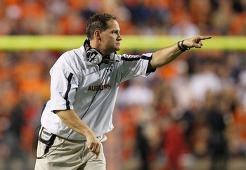 AUBURN, AL - NOVEMBER 13:  Head coach Gene Chizik of the Auburn Tigers points to his offense during the game against the Georgia Bulldogs at Jordan-Hare Stadium on November 13, 2010 in Auburn, Alabama.  (Photo by Kevin C. Cox/Getty Images)