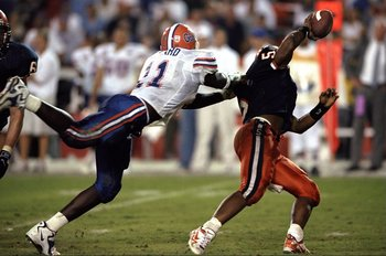 1 Jan 1999: Donovan McNabb #5 of the Syracuse Orangeman is sacked by Thaddeus Bullard #11 of the Florida Gators during the Orange Bowl at the Orange Bowl in Miami, Florida. Florida defeated Syracuse 31-10. Mandatory Credit: Harry How  /Allsport