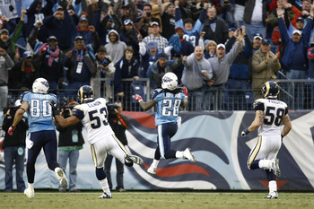 NASHVILLE, TN - DECEMBER 13: Chris Johnson #28 of the Tennessee Titans jumps across the goal line to score his second touchdown in the first half against the St. Louis Rams at LP Field on December 13, 2009 in Nashville, Tennessee. (Photo by Joe Robbins/Ge