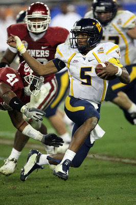 GLENDALE, AZ - JANUARY 02:  Quarterback Patrick White #5 of the West Virginia Mountaineers runs the ball against the Oklahoma Sooners in the second half at the Tostito's Fiesta Bowl at University of Phoenix Stadium January 2, 2008 in Glendale, Arizona.  (