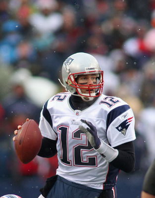 ORCHARD PARK, NY - DECEMBER 26: Tom Brady #12 of the New England Patriots looks to pass against the Buffalo Bills  at Ralph Wilson Stadium on December 26, 2010 in Orchard Park, New York. New England won 34-3.  (Photo by Rick Stewart/Getty Images)