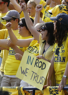 ANN ARBOR, MI - SEPTEMBER 05:  A fan in the student section holds up a sign supporting head coach Rich Rodriguez during a game between the Western Michigan Broncos and the Michigan Wolverines on September 5, 2009 at Michigan Stadium in Ann Arbor, Michigan